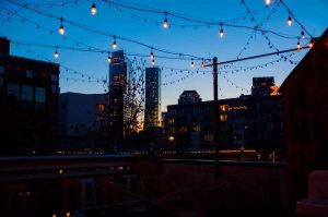 Patio Cielo rooftop at night with stings of hanging lights